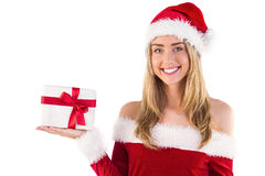 Pretty santa girl holding gift Royalty Free Stock Photos
