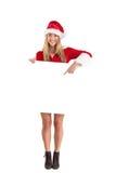 Pretty santa girl holding poster Royalty Free Stock Photography