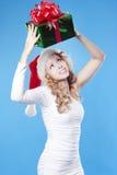 Pretty Santa girl with a present gift for Ne Stock Photos