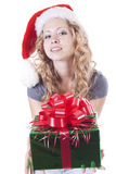 Pretty Santa girl with a present gift for New Year Royalty Free Stock Photography