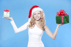 Pretty Santa girl with a present gift for New Year Stock Photos