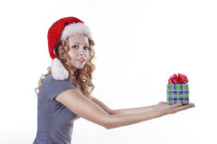 Pretty Santa girl with a present gift for New Year Royalty Free Stock Photo
