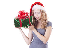 Pretty Santa girl with a present gift for New Year Stock Images