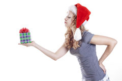 Pretty Santa girl with a present gift for New Year Stock Image