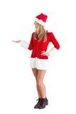 Pretty santa girl presenting with hand Stock Photo