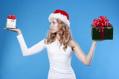 Pretty Santa girl receiving a present gift for New Stock Photography