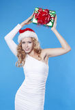Pretty Santa girl receiving a present gift for New Stock Image