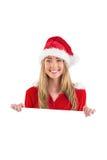 Pretty santa girl smiling at camera with poster Royalty Free Stock Photos