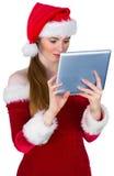 Pretty santa girl using tablet pc Royalty Free Stock Photo