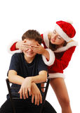 Pretty Santa playing with the boy. Royalty Free Stock Image