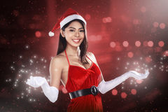 Pretty Santa Woman Holding Merry Christmas Board Royalty Free Stock Photo