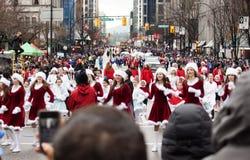 Pretty santas at christmas parade Royalty Free Stock Photography