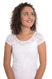 Pretty satisfied young woman isolated in white shirt looking up. Royalty Free Stock Images