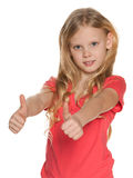 Pretty nordic girl holds her thumbs up Stock Photo