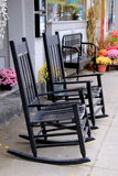 Pretty scene with rocking chairs and colorful mums Royalty Free Stock Photography