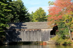 Pretty scene of rustic covered bridge in Fall Stock Image