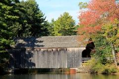 Pretty scene of rustic covered bridge in Fall Stock Image