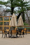 Pretty scene with tables and umbrellas set for visitors at outdoor eatery Stock Image