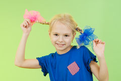 Pretty schoogirl in bright clothing or fancy dress Royalty Free Stock Photos