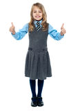 Pretty school child showing thumbs up gesture Royalty Free Stock Photo