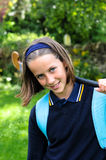 Pretty school girl. Closeup of school girl carrying hockey stick Royalty Free Stock Photo