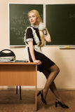 Pretty school girl in a classroom Royalty Free Stock Photos