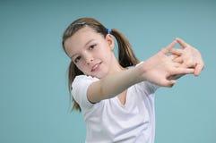 Pretty school girl exercising Stock Photo