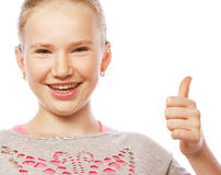 Pretty school girl pointing her index finger upwards in exciteme Royalty Free Stock Photography