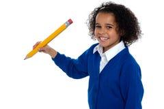 Pretty school kid facing camera Stock Images