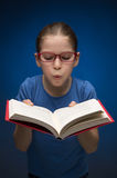 Pretty schoolgirl with book. Royalty Free Stock Photos