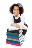 Pretty schoolgirl reading a textbook Royalty Free Stock Photo