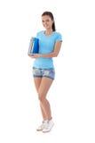 Pretty schoolgirl in shorts smiling Stock Image