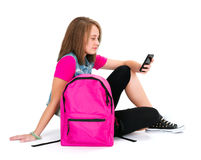 Pretty schoolgirl with smartphone Royalty Free Stock Image