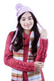 Pretty schoolgirl smiling with winter clothes Stock Photography
