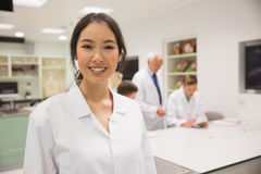 Pretty science student smiling at camera Royalty Free Stock Photo