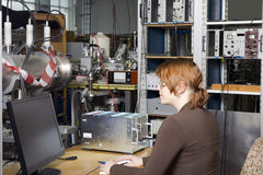 Pretty scientist in nuclear- electronic laboratory Royalty Free Stock Photo