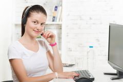 A pretty secretary with a headset Royalty Free Stock Image