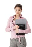 Pretty secretary holding folders smiling Stock Photo
