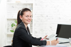 A pretty secretary looking at a digital tablet Royalty Free Stock Photography