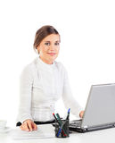 Pretty secretary at work. Pretty young businesswoman sitting at her desk in the office Stock Photos