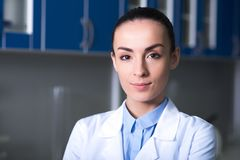 Pretty self-confident researcher standing and looking straight. royalty free stock photos