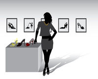 Pretty seller. Offering a shoes in shop (vector Royalty Free Stock Photo