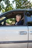 Pretty senior woman driving car Stock Photo