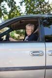 Pretty senior woman driving car. Portrait of pretty senior woman driving car Stock Photo