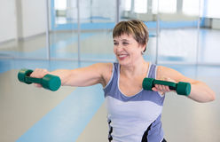 Pretty senior woman exercising in gym Stock Image