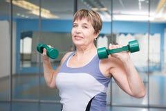 Pretty senior woman exercising in gym Royalty Free Stock Photo