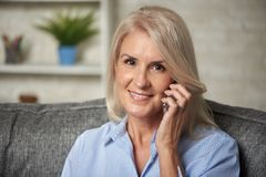Pretty Senior Woman Talking On A Phone At Home Royalty Free Stock Photo