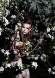 Pretty sensual girl in a garden. Creative makeup Stock Photo