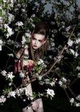 Pretty sensual girl in a garden. Creative makeup stock photo