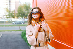 Pretty sensual woman in coat posing in the city, street fashion Royalty Free Stock Photography